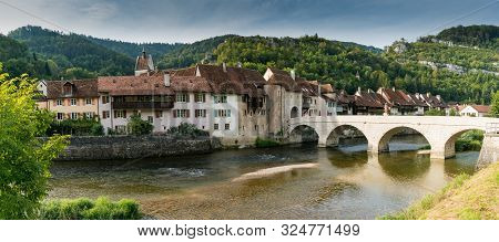 Panorama View Of A Picturesque Village With Old Houses In A River And Forest Landscape In Switzerlan