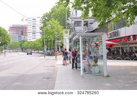 Berlin Germany - June 10, 2019: Unidentified People Wait For Bus In Downtown Berlin Germany