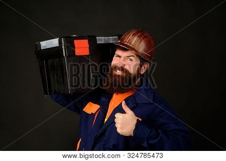 Tools For Repair. Builder Man Carrying Tool Box Giving Thumbs Up. Repairman In Overall Hold Toolbox.