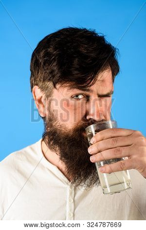 Healthy Nutrition. Drinking Water. Handsome Bearded Man Holds Glass Of Fresh Water. Man Drinking Wat