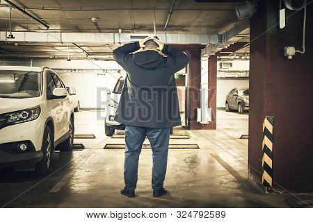 Astonished And Surprised Man Discovered Loss Of Car In Underground Garage Parking Lot. Stolen Car Co