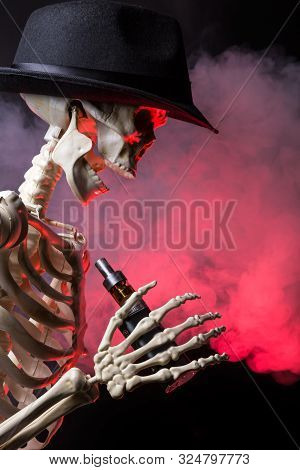Skeleton Wearing A Hat Vaping Clouds Of Red Highlighted Vapor With An Ecigarette