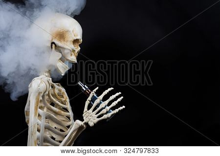 Skeleton Vaping Clouds Of Vapor With An Ecigarette