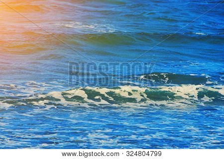 Abstract Clean Sea Background, View On Ripple Foam Surface Of Water. Deep Turquoise Blue Ocean Waves