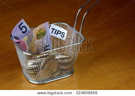 An Invitation To Contribute To The Tips Basket In At A Restaurant.