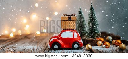 New Year Decoration And Background For Greetings With Free Space For Text. Toy Car Carries A Gift On