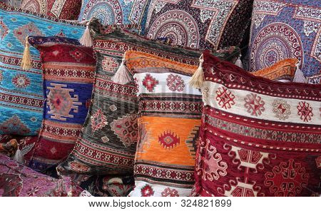 Colorful oriental pillows pile with decorative pattern