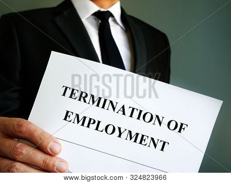 Man Is Holding Termination Of Employment Papers.