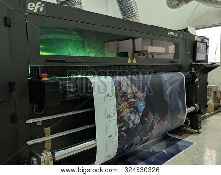 Jakarta, Indonesia - August 14, 2019: A Printing Press Machine Prints Large Images.