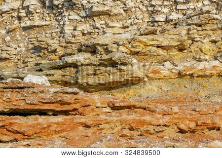 Geological Layers Of Earth - Layered Rock. Close-up Of Sedimentary Rock By Ocean.