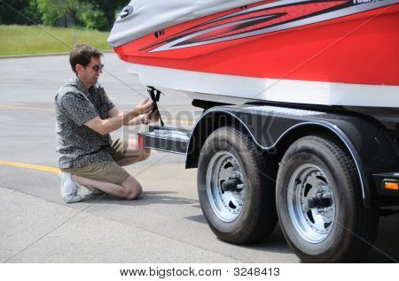 Adjusting Tie Down Straps On Boat Trailer
