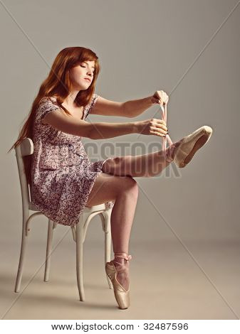 Redhead Girl Trying On Pointe Shoes