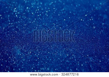 Blue Glittering Christmas Lights. Blurred Abstract Holiday Background