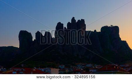 Colorful sky ana silhouette of The Merera rocks at dawn, Kalabaka, Greece -  Greek landscape