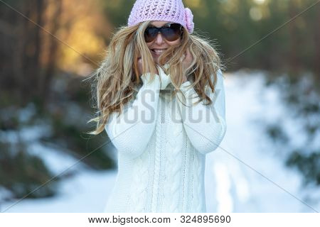 Happy Woman Wearing A Big Woolly Polo Neck Sweater In The Snow