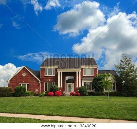 Brick Suburban Home On A Hillside