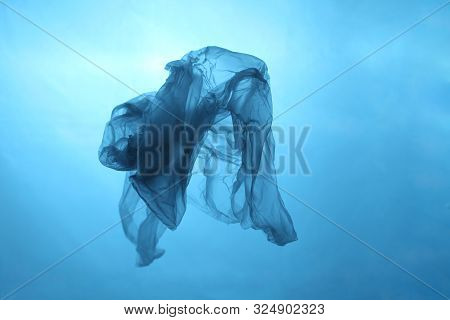 Plastic Bag In Blue Water, Garbage Under Water, Plastic Pollution Of The Oceans.