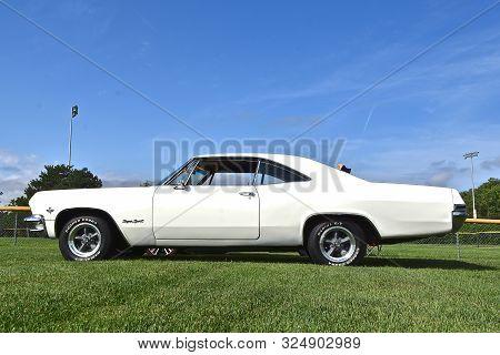 Yankton, South Dakota, August 16, 2019: A Classic Restored 1965 Chevrolet  Impala Super Sport Is Dis