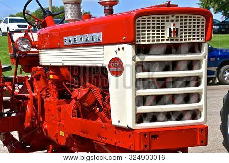 Yankton, South Dakota, August 16, 2019: A Restored Farmall 560 Diesel Tractor Displayed At The Annua