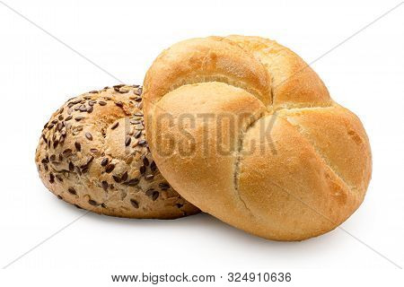 Plain Kaiser Roll On Top Of Whole Wheat Kaiser Roll With Seeds Isolated On White.