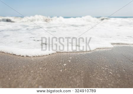 View From The Shore On A Hectic Ocean With White Foam With Waves With Clear Blue Sky In A Sunny Summ