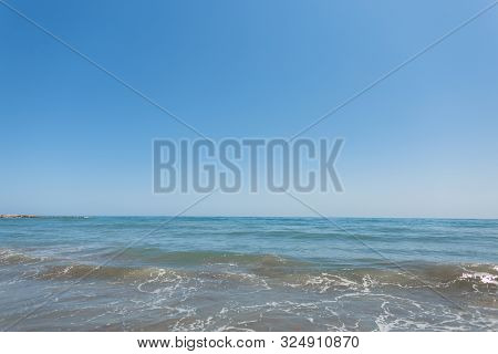 Beautiful Sea And Clear Blue Sky In Daytime For Background. Ocean Horizon. Summer.