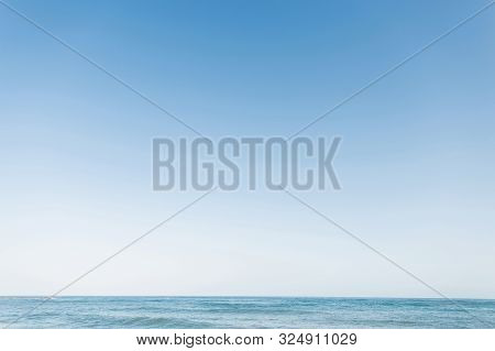 Beautiful Blue Clear Sky And The Sea. Calm Water. Summer Photo. Ocean Horizon.