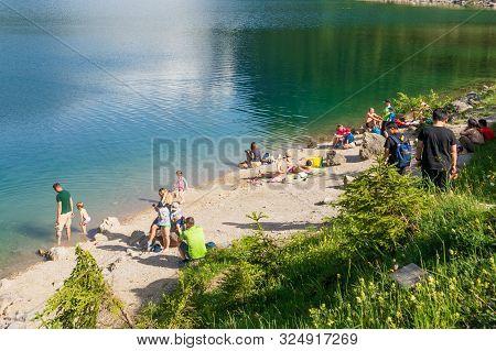 People Enjoying The Beautiful Lake Gosau