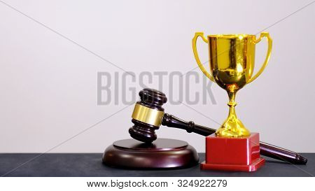 Judges Gavel And Trophy On White Background. Symbol For Jurisdiction. Law Concept A Wooden Judges Ga