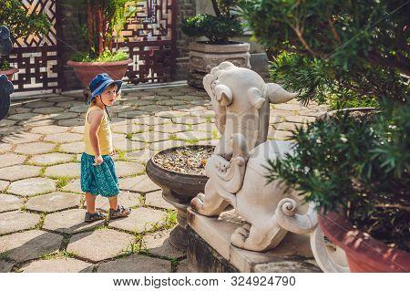 Boy Tourist In Buddhist Temple In Vietnam Nha Trang