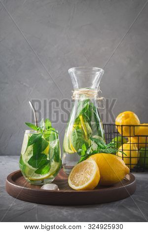 Infused Water With Lemon, Ginger And Mint In Glass. Close Up. Healthy Detox Drink.