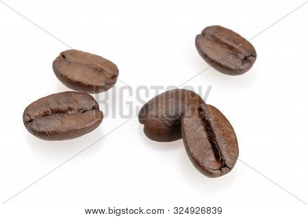 Coffee Beans On A White Background. Fragrant Roasted Brown Coffee Tree Grains. Close-up Isolated