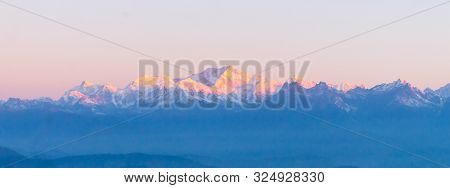 Panorama Of Majestic Mount Kanchendzonga Range Of Himalayas At First Sunrise From Tiger Hill. First