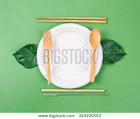 Unbleached Plant Fiber Food Box With Wooden Utensil And Green Leaves. No Plastic Eco Friendly Concep