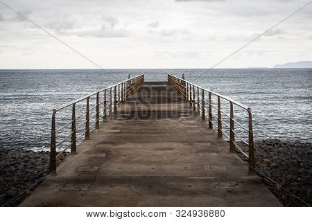 Pontoon To The Sea In The Island Of Madeira