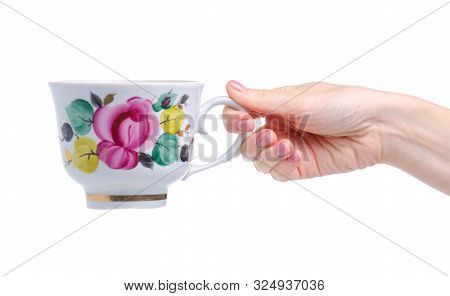 Old Cup Mug With Flowers In Hand On White Background Isolation