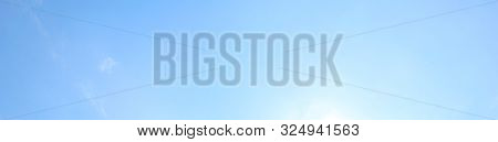 Blue Sky Bright Background With Light Sky Texture On Sunny Day. Soft Azure Colored Long Wallpaper Of