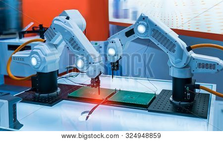 automatic robot for print circuit board (PCB)assembly machine during soldering or welding part at factory