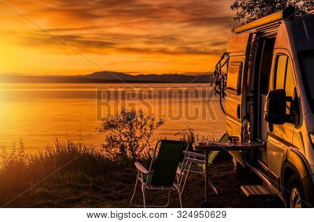 Class B Motorhome Rv And The Scenic Sea Front Sunset. Road Trip Camping. Recreation Vehicle Theme.