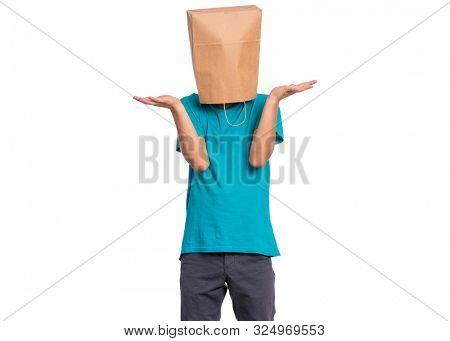 Portrait of teen boy with paper bag over head, showing helpless gesture with hands - I do not know, isolated on white background. Shrugging, shy child making helpless sign.