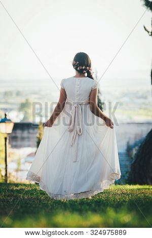 Beautiful Girl With Communion Dress In The Park