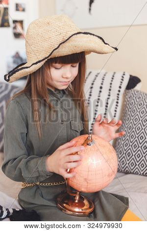 Portrait Of Lovely Girl In Hat Exploring Globe In Dreams About Travel