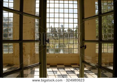 Beautiful Wooden Frame Window In Old Building Without People. Old Building Consisting Of Frame Windo