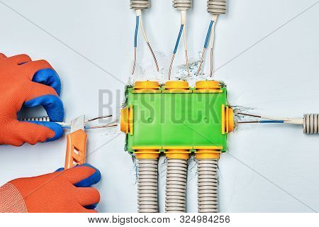 Residential Electrical Services, Installation Of Plastic Junction Box Or Electrical Box. Connecting
