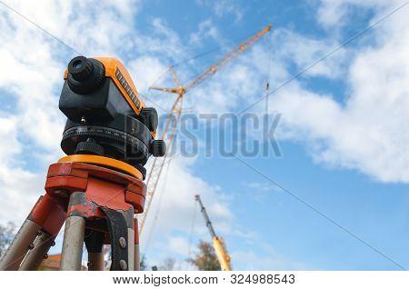 Surveyor Equipment At A Construction Site. Measuring Instrument Close-up.