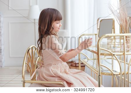 Cute Little Girl Near Oval Mirror At Dressing Table