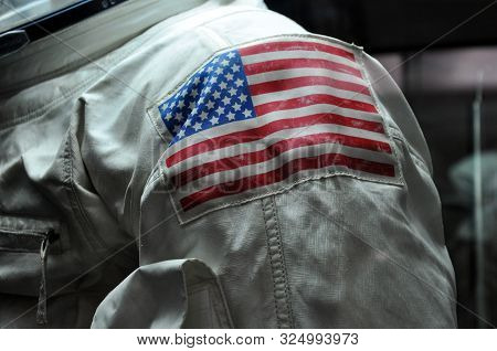 American Flag On The Shoulder Of An Astronaut's Spacesuit.