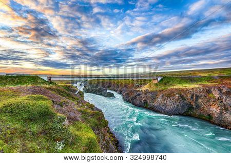 Incredible Landscape Scene Of Skjalfandafljot River Near Godafoss Waterfall. Bridge Over River Skjal