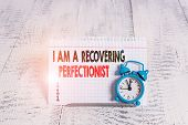 Conceptual hand writing showing I Am A Recovering Perfectionist. Business photo text Obsessive compulsive disorder recovery. poster