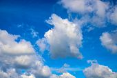 White cloud on azure sky. Sunny cloudscape photo background. Idyllic skyscape with fluffy cloud. Fluffy cloud on sunny sky. Cotton softness concept. Zen or relax cover template. Cloudy sky overcast poster